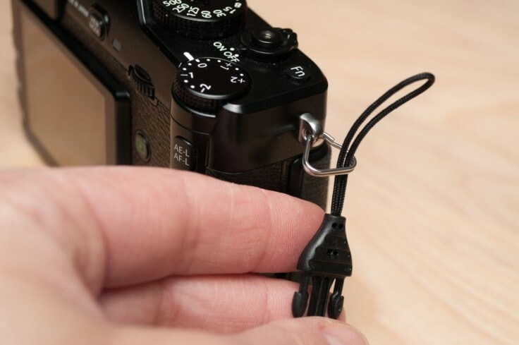 Thread the cord loop through the split ring.