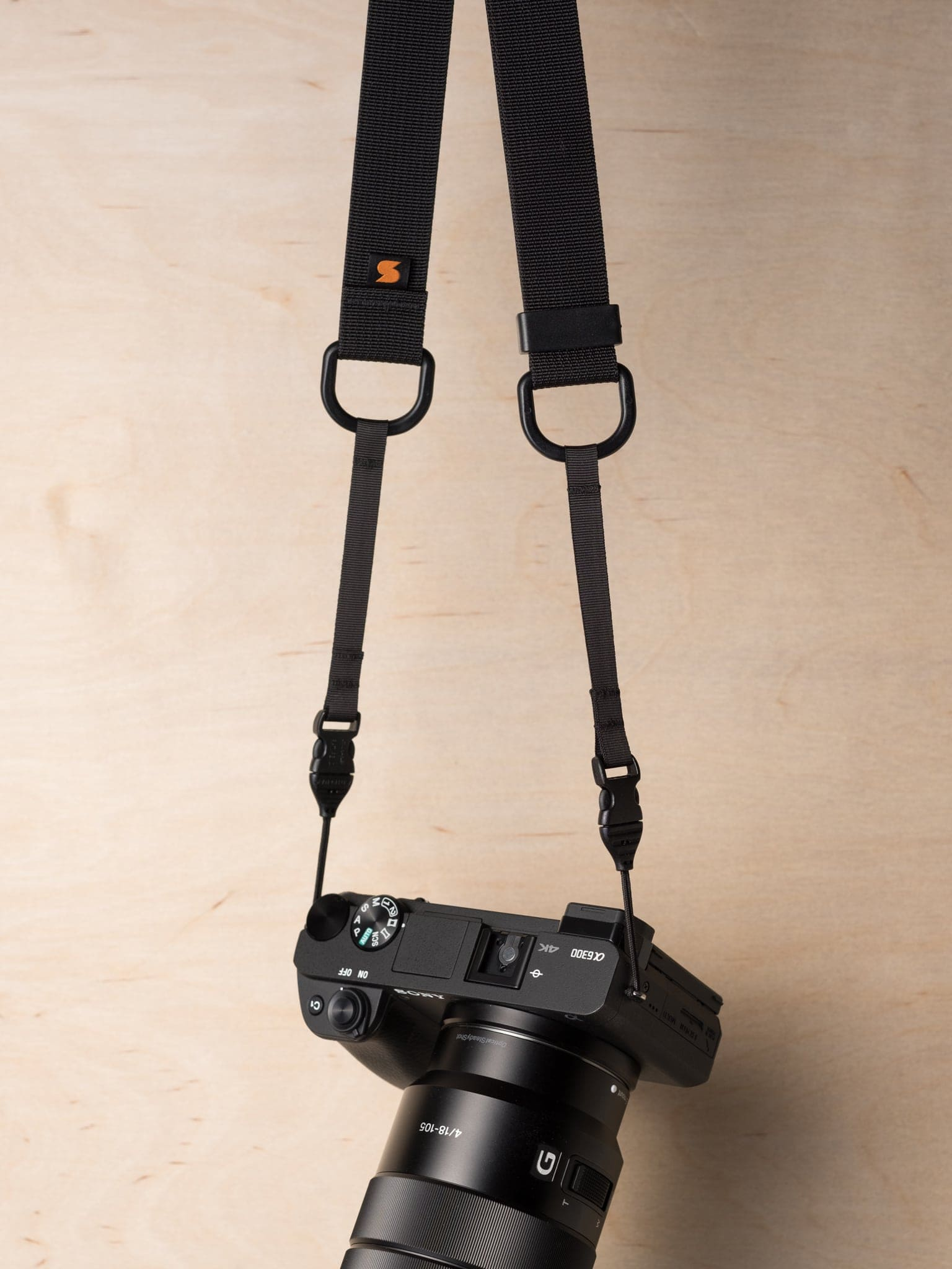 how to put on a camera strap sony