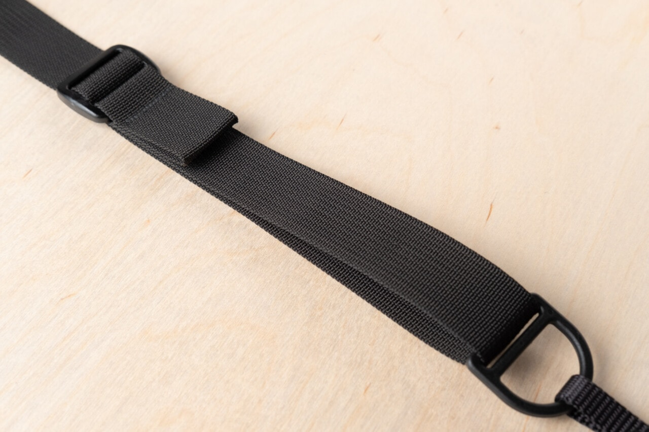F1's Adjustment Tab quickly tailors strap length without over-engineered hardware.