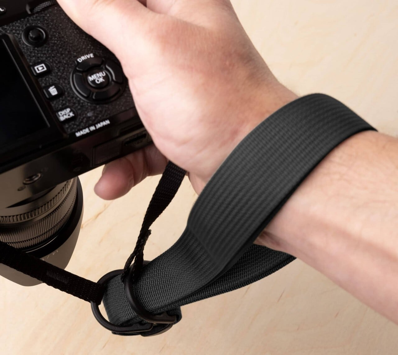 Loop the webbing through the D-rings to use the F1 as a wrist strap.